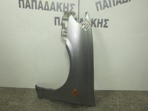 Nissan Almera N16 2002-2006 φτερό εμπρός αριστερό ασημί