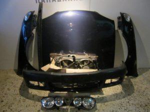 Toyota Corolla 2000-2002 μούρη μπλε σκούρο: καπό- 2 φτερά- 2 φανάρια- προφυλακτήρας- ψυγεία κομπλέ- τραβέρσα προφυλακτήρα